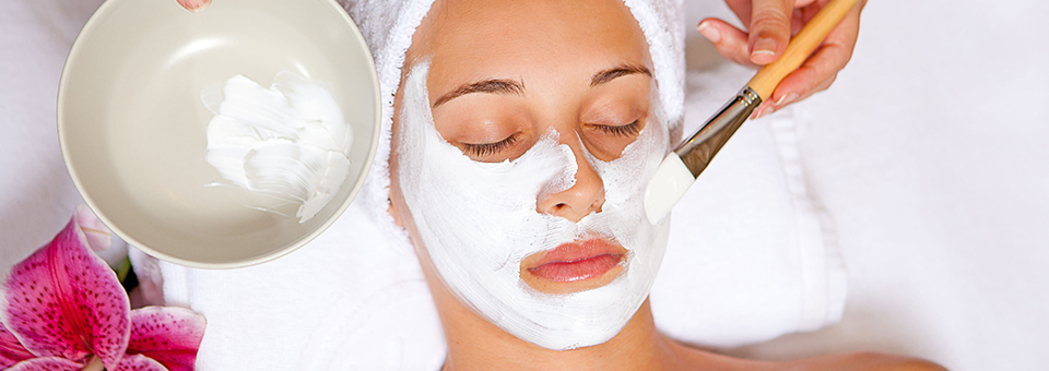 woman at spa having relaxing face mask